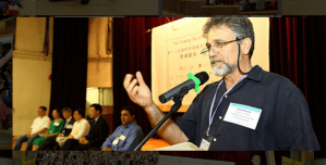Mitchell addressing Hong Kong conference