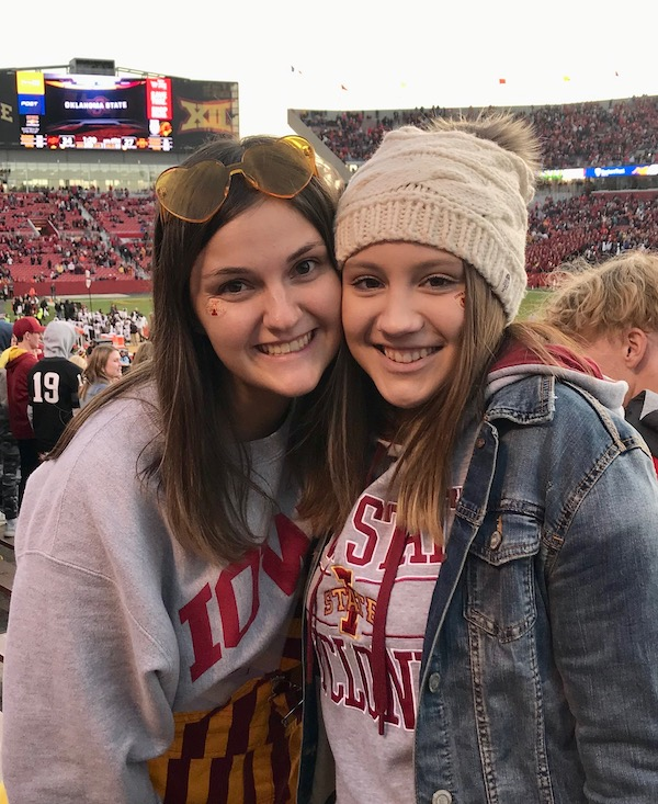 Two college students at football game.