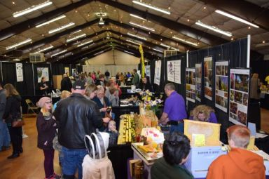 crowd visiting vendors at local foods event