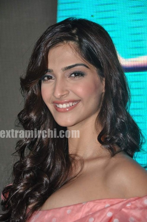 Sonam-Kapoor-with-Coral-voile-polka-dot-fitted-dress-from-Vivienne-Westwood-6.jpg