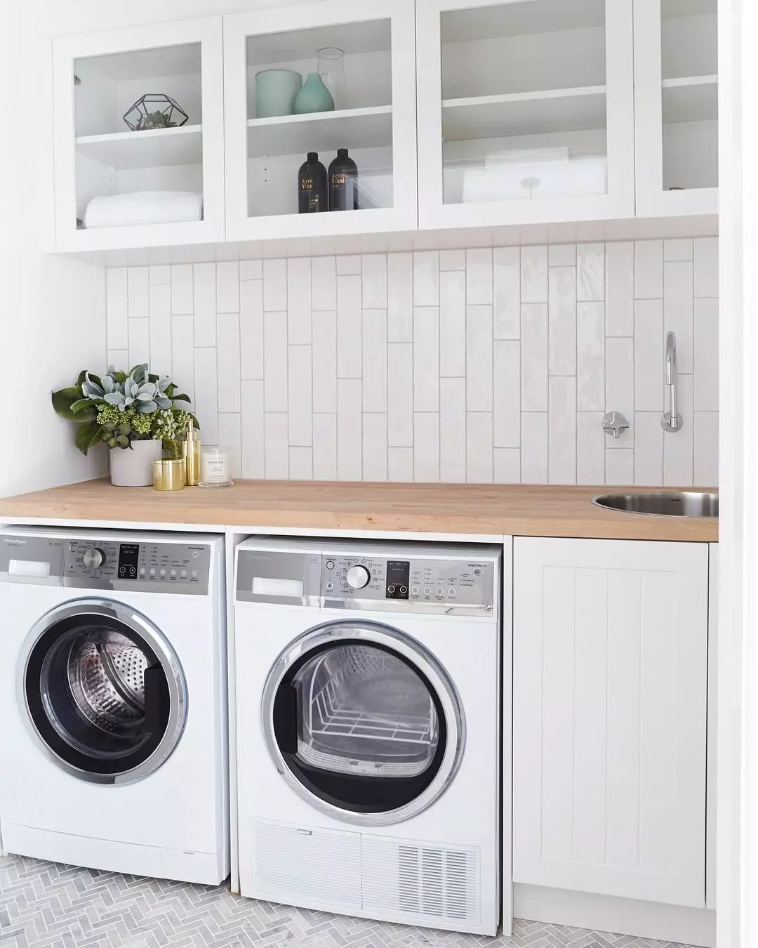 Washer-dryer combo in laundry room. Photo by Instagram user @threebirdsrenovations