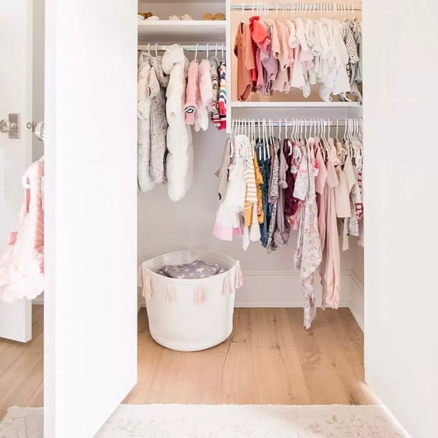 Closet full of baby clothes on multiple levels. Photo by Instagram user @twigandtassel