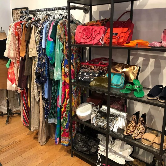 Hanging Rack with Dresses and Shelves with Purses and Women's Shoes. Photo by Instagram user @housingworks