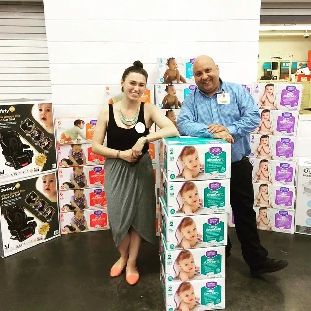 Volunteers with Donated Diapers, Kids Car Seats, and Other Supplies. Photo by Instagram user @lehelps