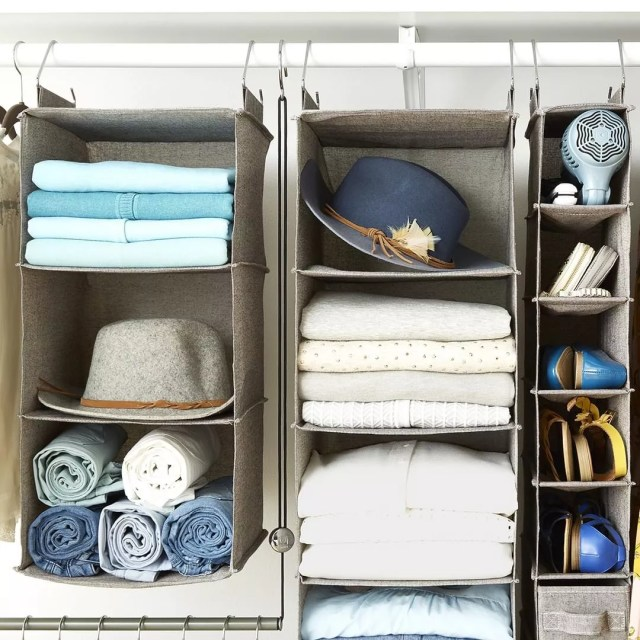 Gray hanging storage filled with hats and shirts. Photo by Instagram user @thecontainerstore