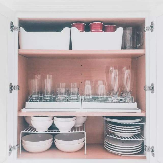 Kitchen cabinet with dish organizers. Photo by Instagram user @house_on_lew