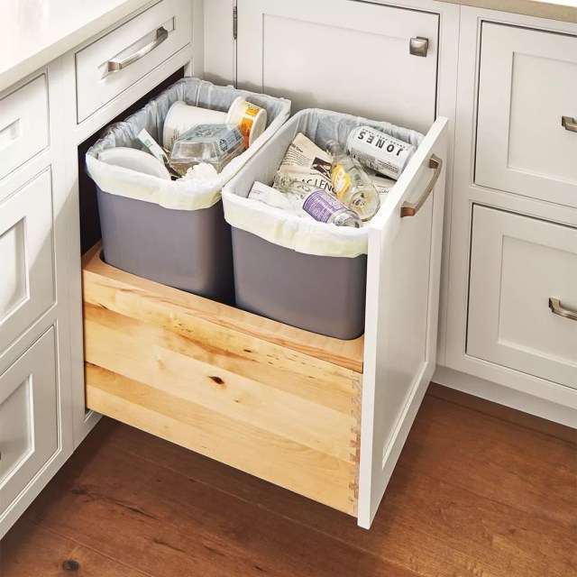 Hidden trash kitchen cabinet. Photo by Instagram user @masterbrandcabinets