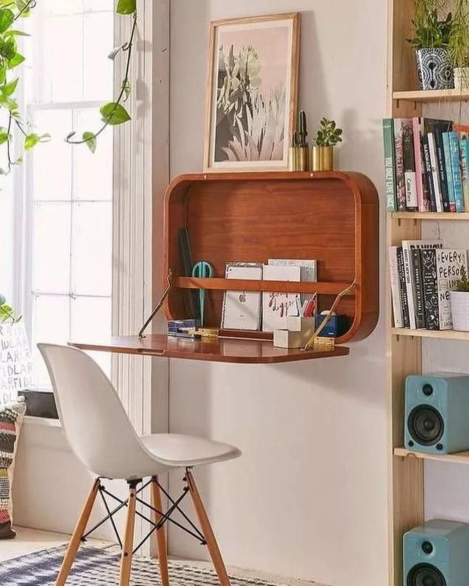 Fold-down hideaway desk in apartment. Photo by Instagram user @socalselfstorage