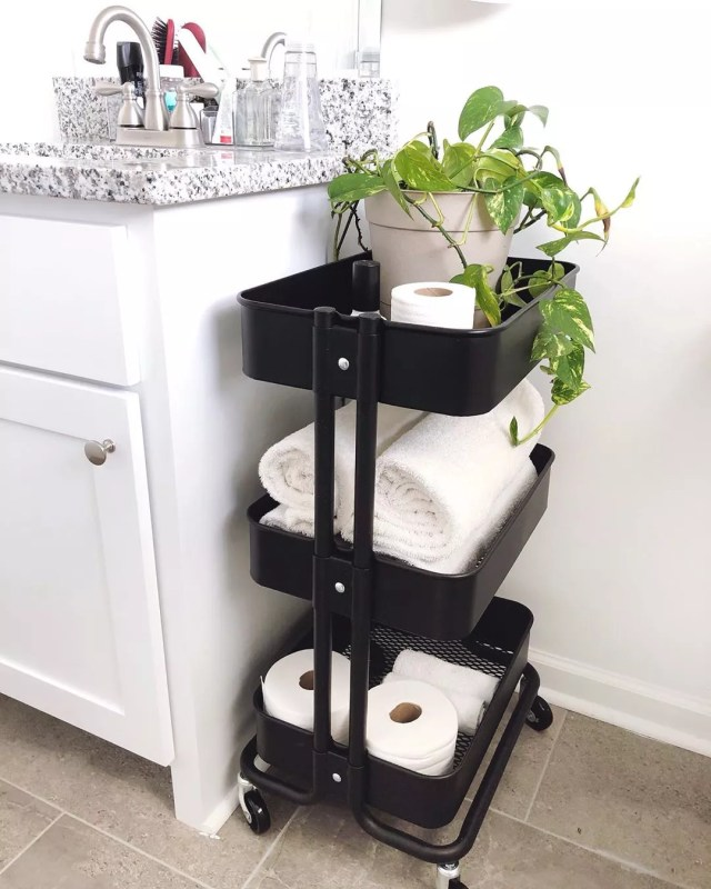 Utility cart in bathroom. Photo by Instagram user @lelaburris