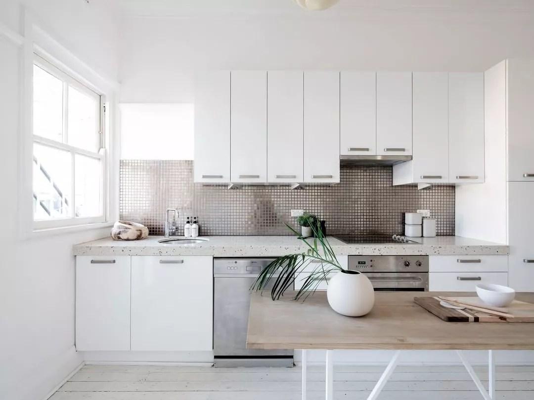 Staged minimalist kitchen. Photo by Instagram user @bellepropertysurryhills