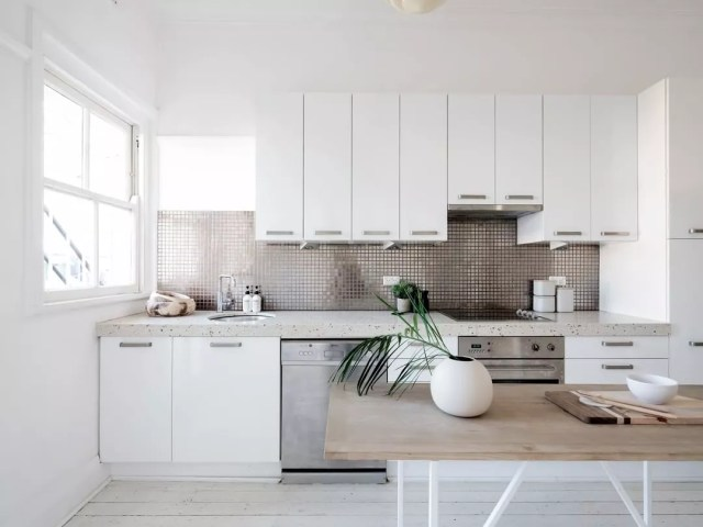 Staged minimalist kitchen. Photo by Instagram user @bellepropertysurryhills