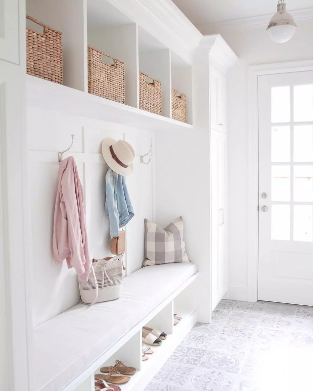 Clean, white mudroom. Photo by Instagram user @jseveryday