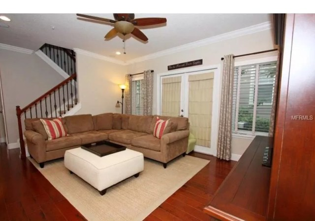 Before real estate photo of living room that doesn't show space well