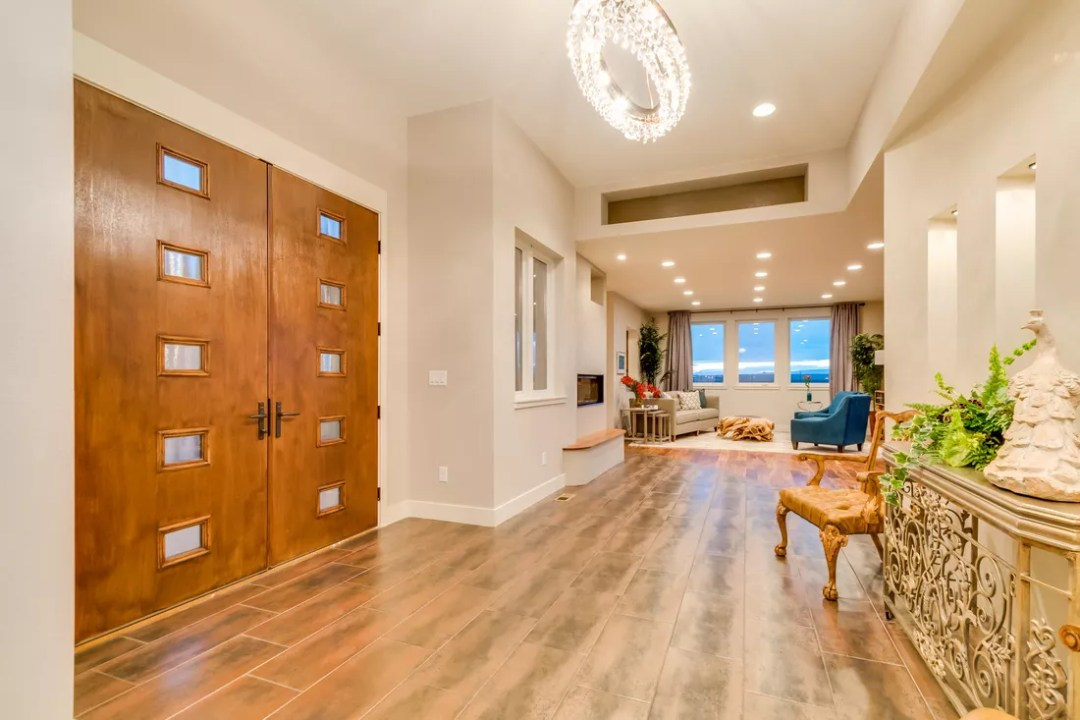 Professional real estate photo of entryway and living room taken by SoCo Home Photography