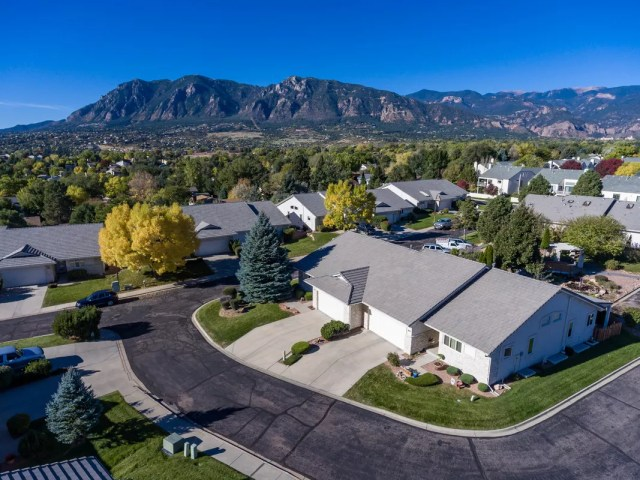 Aerial photo of home and mountains