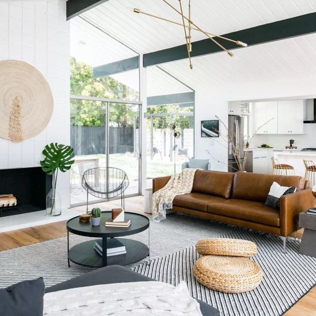 Living room with modern furniture staged for showings. Photo by Instagram user @molgoodman