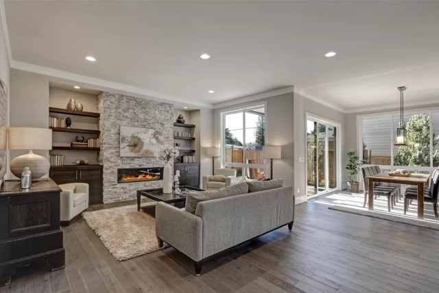 Living room with grey, neutral walls.