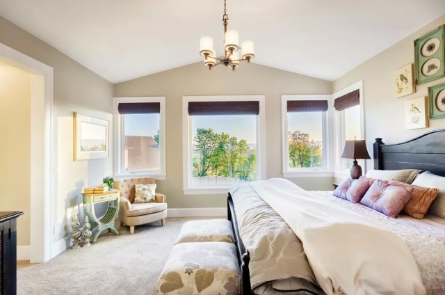 Staged bedroom with open windows and great lighting