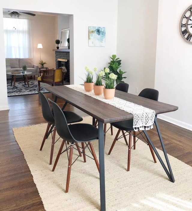 Staged home with modern dining room. Photo by Instagram user @layofthelandstaging