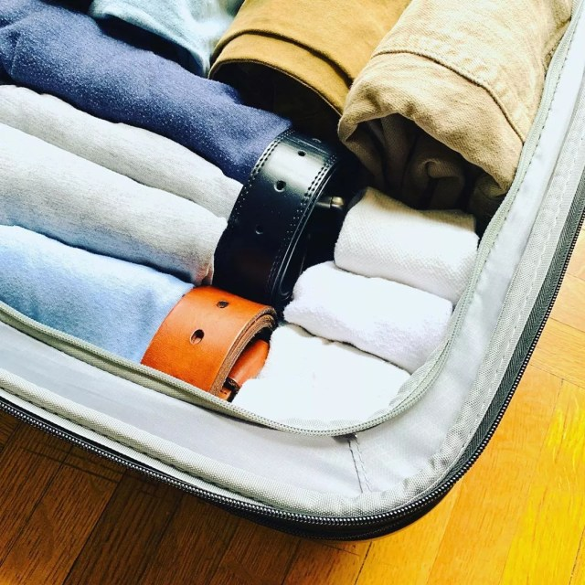 Rolled clothes in suitcase. Photo by Instagram user @simplejoywithann
