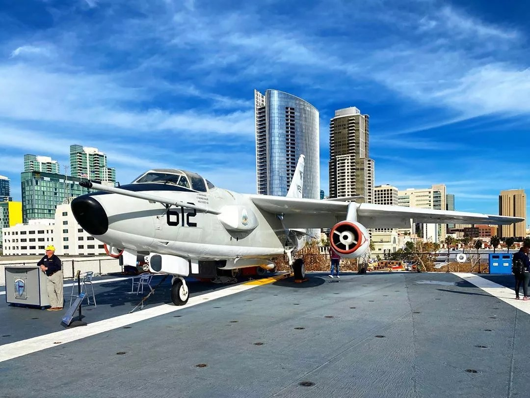 downtown San Diego from USS midway with plane photo by Instagram user @pjcotravels