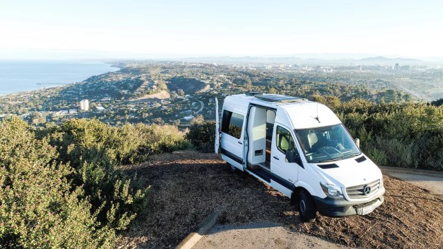 Sprinter van parked in mountains. Photo by Instagram user @advanture.co