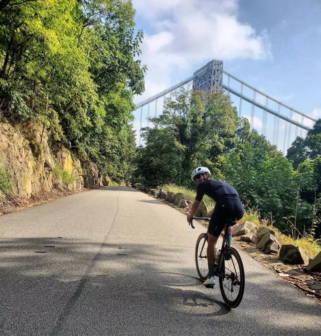 Man riding bike near George Washington Bridge. Photo by Instagram user @twj_17_