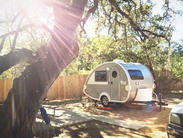 Teardrop camper parked at campsite. Photo by Instagram user @happycamperwives