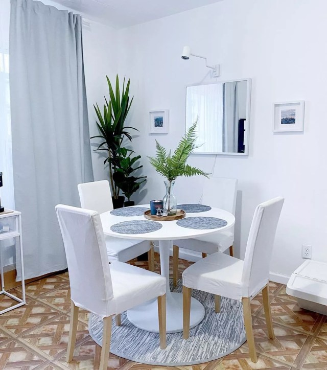 Small dining table in white apartment. Photo by Instagram user @fgpavon