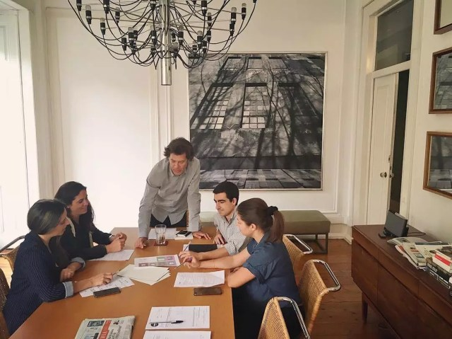People Working Together in a Small Conference Room. Photo by Instagram user @globalpress