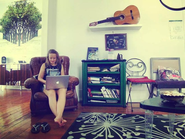 Woman Working at Home in a Leather Chair. Photo by Instagram user @carolinkraft