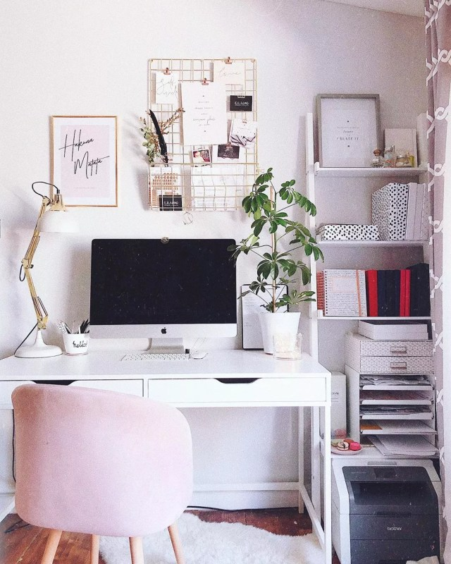 Pink, white, and gold home office space. Photo by Instagram user @ellaiconic