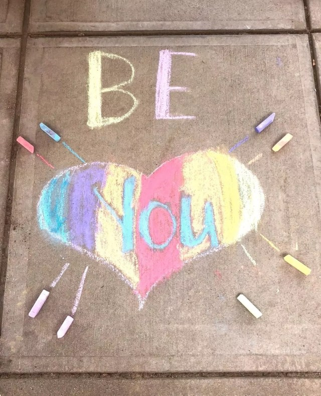 Rainbow chalk art on sidewalk that says be you. Photo by Instagram user @framinghamfpa