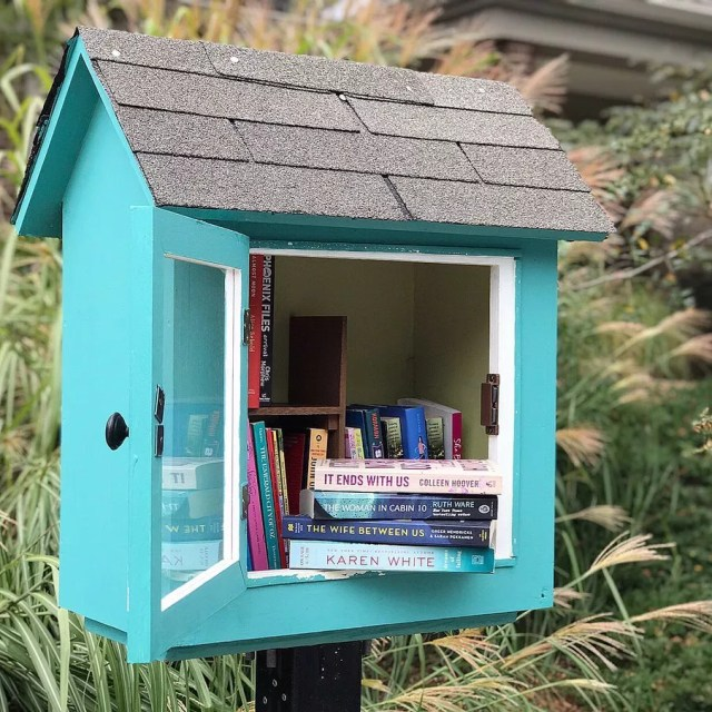 Blue bird box filled with books. Photo by Instagram user @mrsboomreads