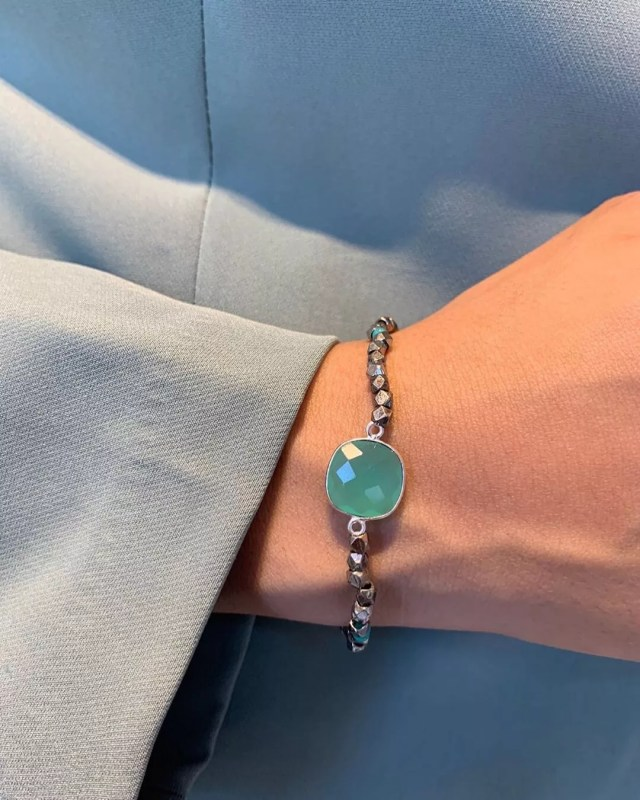 Girl wearing blue bracelet. Photo by Instagram user @birdandstone