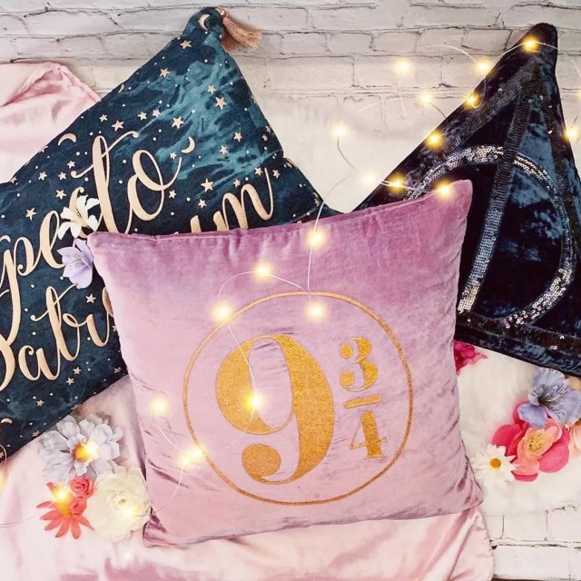 Pink and green Harry Potter pillows. Photo by Instagram user @potterybarnteen