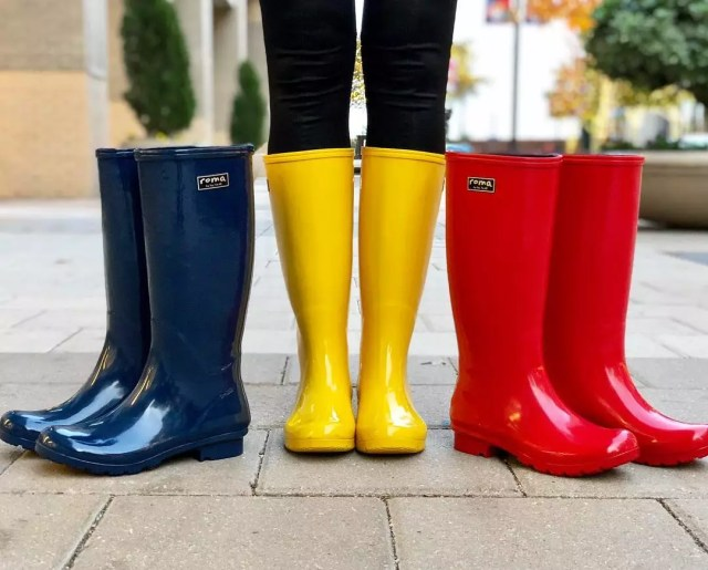 Blue, yellow, and red rain boots. Photo by Instagram user @romaboots