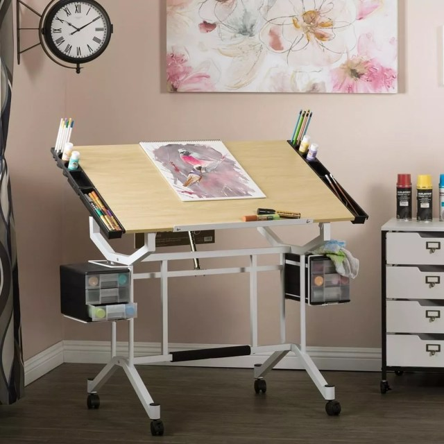 Adjustable craft room drawing table. Photo by Instagram user @studio_designs_inc