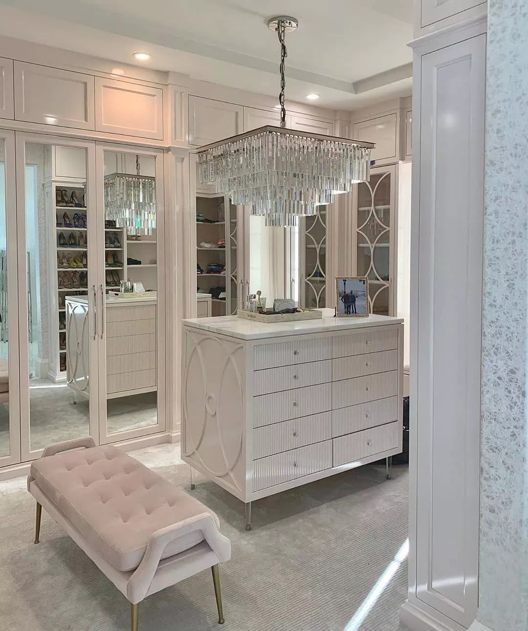 Contemporary walk-in luxury closet. Photo by Instagram user @cm.closetdesign