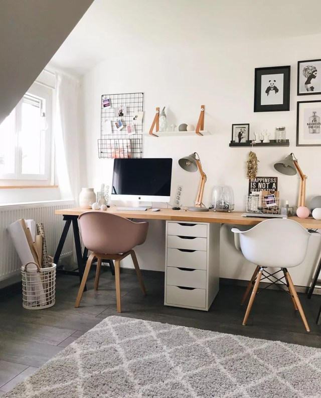 side by side desk space with wooden desk top and multi colored chairs photo by Instagram user @aplaceforus