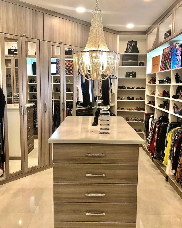 Closet with glossy tile floor. Photo by Instagram user @designedbyangelina