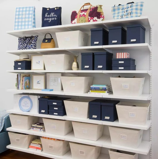 Neatly Organized Junk Room with Wall Shelving. Photo by Instagram user @thecontainerstore