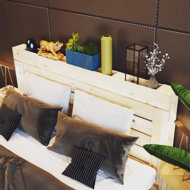 Pictures and Plants Stored on a Headboard made from a Wooden Pallet. Photo by Instagram user @palletbedz