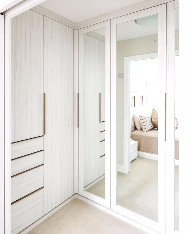 Walk-in closet with floor to ceiling mirrors. Photo by Instagram user @steph.pollard.design