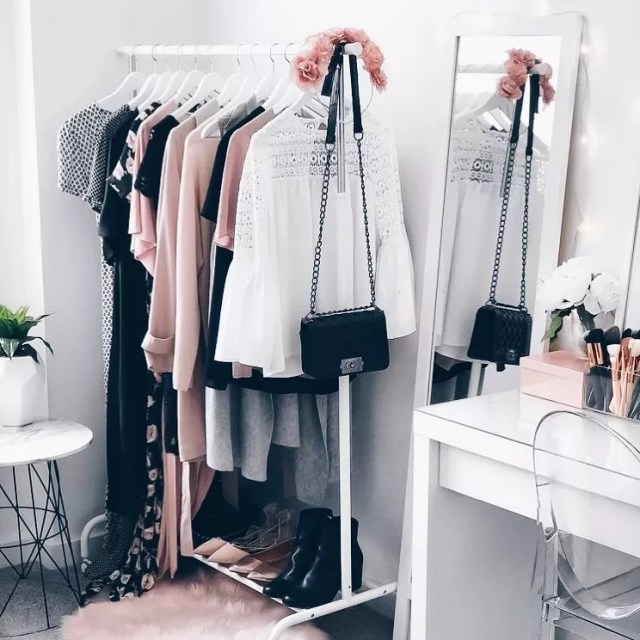 Modern Bedroom with a Hanging Clothes Rack Holding Purses and Women's Clothes. Photo by Instagram user @coconut.ind