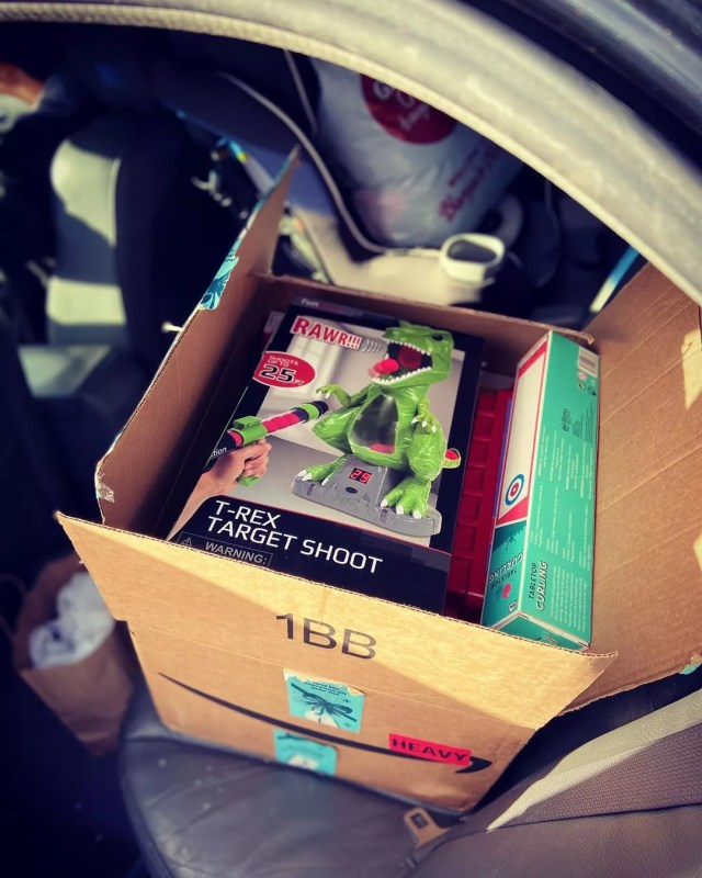 Box with Toys for Donation in Car. Photo by Instagram user @motogirly