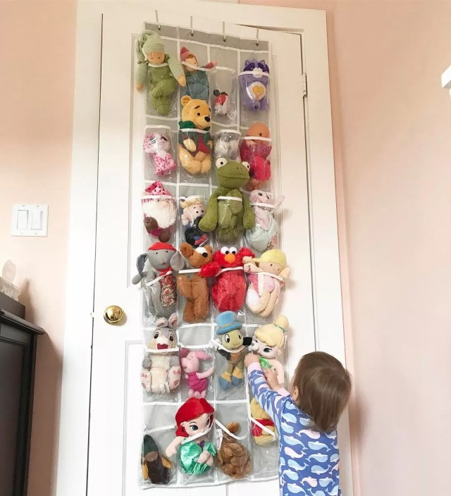Shoe Organized on Back of Closet Door Storing Kids Toys. Photo by Instagram user @notanexpertmom