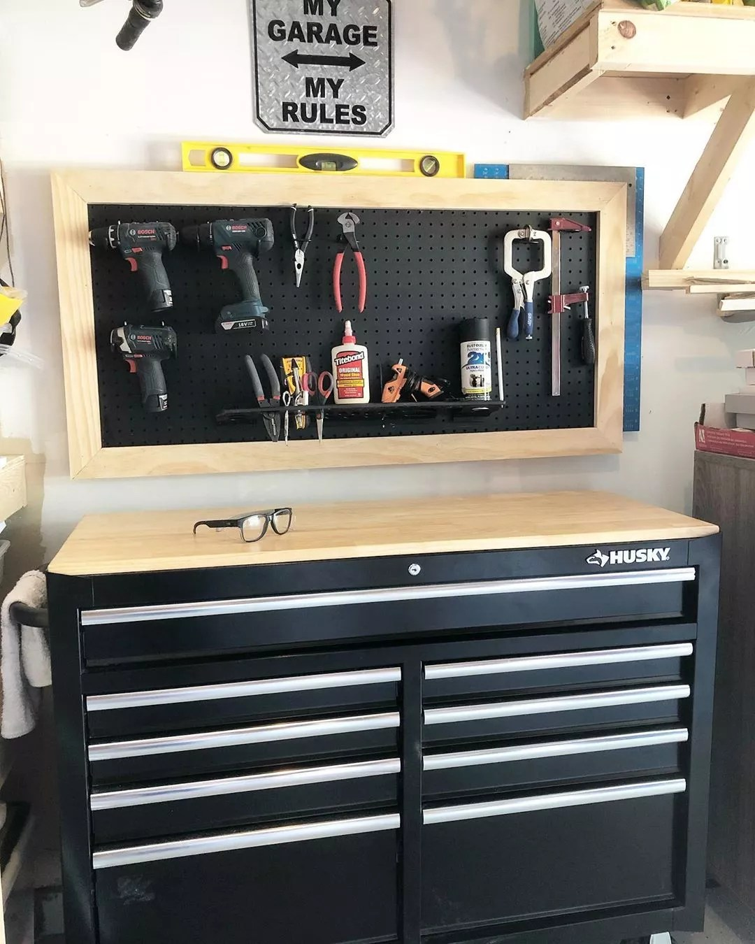 Pegboard with Saws, Hammers, and Tools in a Garage. Photo by Instagram user @daniraehome