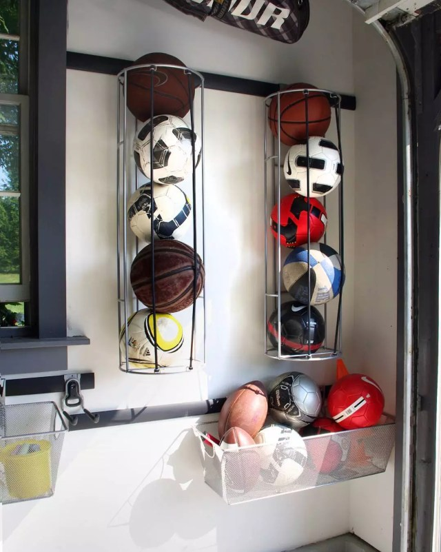 Sports Balls Stored in Vertical Nets in Garage. Photo by Instagram user @rylex_custom_cabinetry