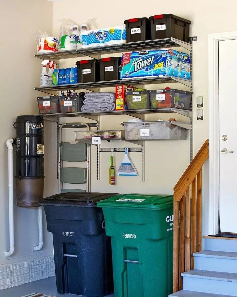 Garbage Cans Stored in Garage. Photo by Instagram user @simpleoverheaddoors